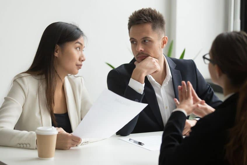 photo of Colleagues thinking looking at each other discussing job applicant resume with female CEO, waiting for decision and thoughts. recruiting problem, reject, bad first impression, failed interview concept